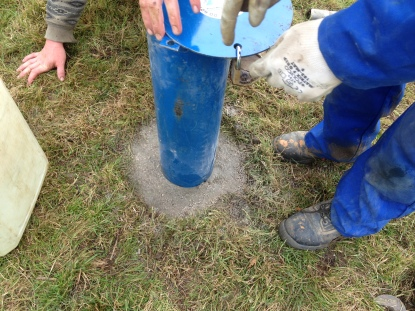 Figure 6 Installation of metal borehole cover, cemented into the ground