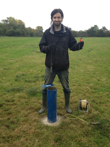 Figure 8 Installation of the groundwater sensor, suspended from a string attached to top of borehole tube