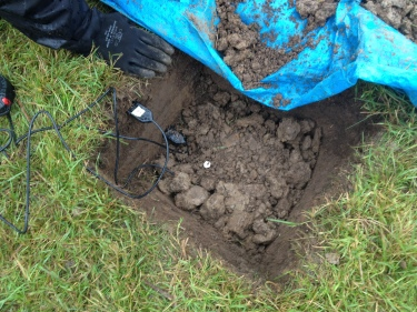 Figure 9 Installation of soil moisture and temperature sensors in soil pit